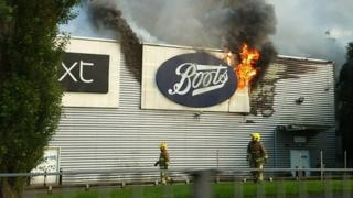 Firefighters at Warrington retail park blaze