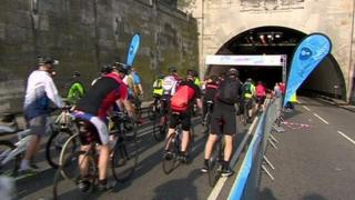 Cyclists riding into the Birkenhead Tunnel