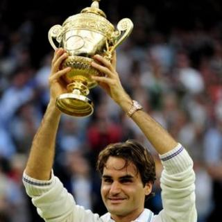 Roger Federer with Wimbledon trophy