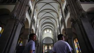 Two men in the church in Shanghai where Bishop Ma is reported to be held