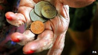 Older person holding coins