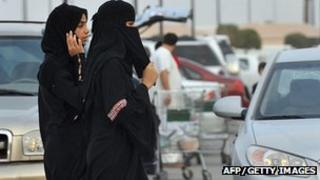 Saudi women walk outside a shopping mall (File)