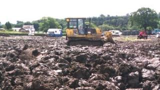 Diggers pulled vehicles out of the mud at the Great Yorkshire Showground in 2012