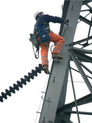 A worker on a pylon