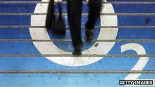 Man walks over O2 logo