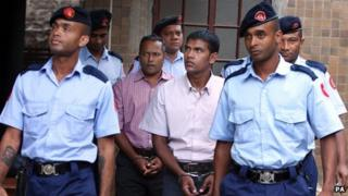 Sandip Moneea, 43 (centre left) and Avinash Treebhoowoon, 32 ( centre right)