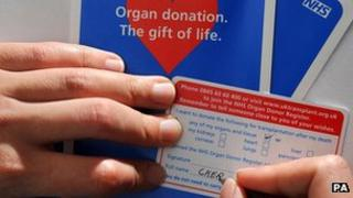 Donor card being signed