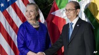 US Secretary of State Hillary Rodham Clinton (l) and Burmese President Thein Sein shake hands before a meeting at Le Meridien Hotel