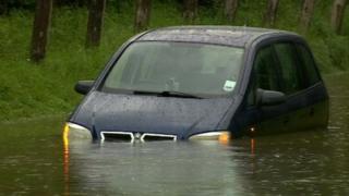 A car stuck in floods