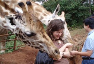 Emma Tracey with a giraffe in Kenya