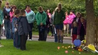 Parents and children attend a vigil for the family in Coleford