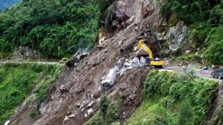Indian personnel clear a landslip at Phengla