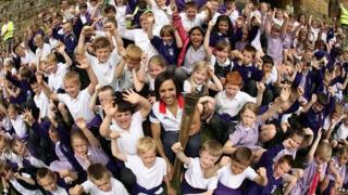 Dame Kelly Holmes with pupils from St. Stephens school in her home village of Hildenborough