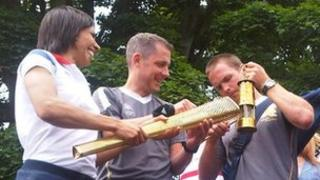 Dame Kelly Holmes and Olympic torch