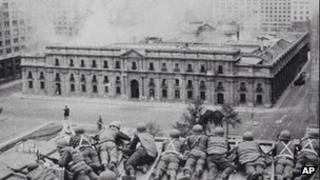 Soldiers supporting the coup led by Gen Augusto Pinochet take cover as bombs are dropped on the Presidential Palace of La Moneda in this 11 September 1973 file photo