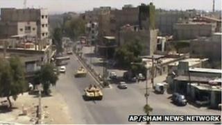 Pictures activists claim show tanks on Damascus's streets