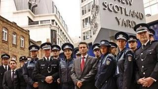 Commissioner Bernard Hogan-Howe with Romanian police officers