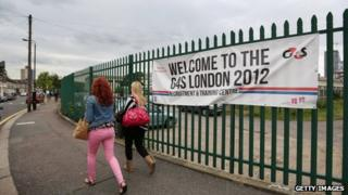 """Prospective G4S employees arrive at their """"London 2012 Recruitment and Training Centre"""" near the Olympic Park site on 17 July"""