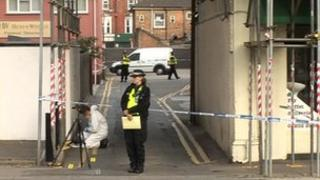 Police and forensic teams investigate the area around the scene