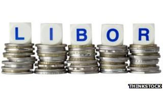 Dice spelling out LIBOR sat on top of piles of coins.