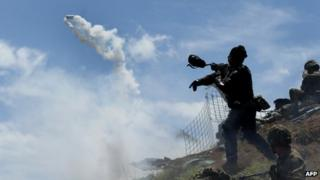 A Colombian soldier wears a gas mask at Cerro Berlin in Cauca province