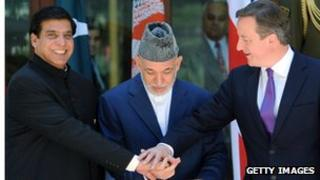 Pakistani PM Raja Pervez Ashfraf (left) Afghan President Hamid Karzai (centre) and British PM David Cameron