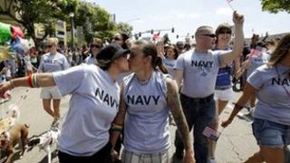 Two female US navy sailors kiss while marching in the San Diego Gay Pride Parade on 16 July 2011 (file photo)
