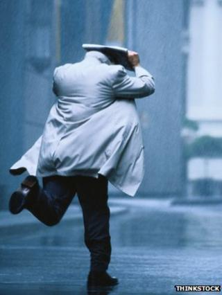 Man running in rain