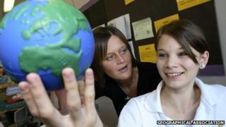 Girl holding toy globe