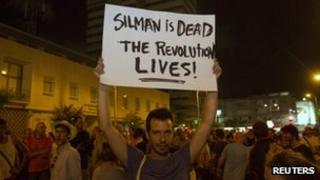 An Israeli activist holds placard during a rally in memory of Moshe Silman in Tel Aviv on 21 July