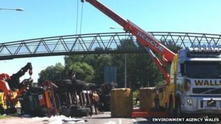 A crane is used to lift the lorry off the Southern Distributor Road in Newport (Pic: Environment Agency Wales)