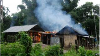 A house burns at Kachugaon village in Kokrajhar district, about 230 kms from Guwahati, the capital city of the northeastern state of Assam during violent clashes on July 23, 2012
