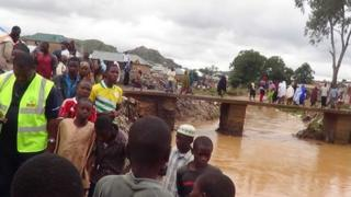 Rescue workers in Jos, Nigeria, following the floods