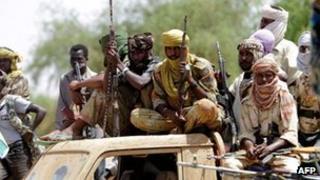 Rebel fighters in Darfur. File photo