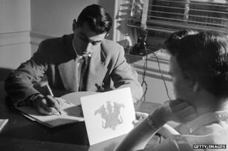 Psychologist conducting Rorschach test