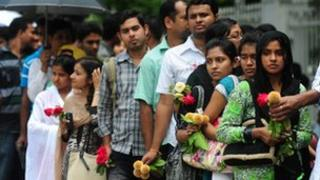 """Bangladeshi youth wait in line to pay their last respects to the country""""s most popular fiction writer, Humayun Ahmed in Dhaka on July 23, 2012."""