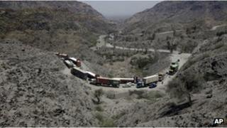 Afghanistan-bound NATO trucks pass through the Khyber Pass in Pakistan on Thursday, July 12, 2012.