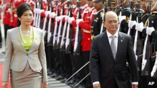 President Thein Sein, right, is accompanied by Thai Prime Minister Yingluck Shinawatra during a welcoming ceremony in Bangkok, Thailand July 23, 2012