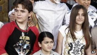 This 26 Jan file photo shows, from left, Prince Jackson, Blanket Jackson and Paris Jackson