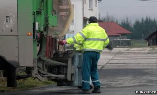 Bin man collecting bins