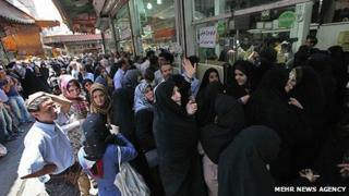 People queuing up for subsidised chicken in Tehran