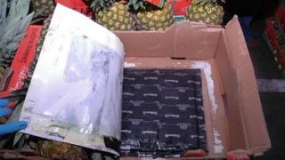 Police photo of pineapple crates which had cocaine hidden underneath