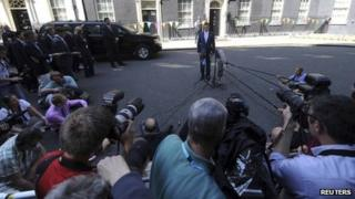 US Republican presidential candidate Mitt Romney talks to the media in Downing Street after his meeting with British Prime Minister David Cameron in London, 26 July 2012