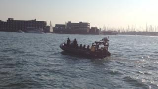 A police boat searching the scene
