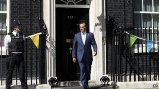 Republican presidential candidate Mitt Romney walks out of 10 Downing Street after meeting with British Prime Minister David Cameron in London, 26 July 2012