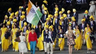 India's Olympic delegation walks in the opening ceremony, accompanied by an unknown gatecrasher wearing a red top and blue trousers (27 July)