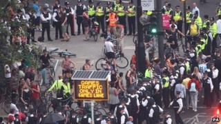 Cyclists and police near the Olympic Stadium