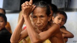 Elderly Bodo woman sits in a relief camp in Assam