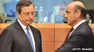 ECB President Mario Draghi and Spanish Finance Minister Luis De Guindos