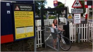 Cyclist using new railway level crossing at Foxton in Cambridgeshire